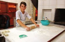 Turkey - a boy working in a kitchen.