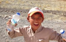 Iraqi Kurdistan - a boy on a road selling water.