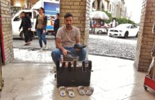 Iraqi Kurdistan - a shoe cleaner in Erbil.